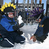123106<br /> Nathan Conner (cq), 6, left, and his brother, Evan Conner (cq), 9, alternate between making snowmen and throwing snowballs at their parents, at the Santa Fe Ski basin on Dec. 31, 2006. The Conner family traveled from El Paso to go skiing and play in the snow for a day. (Photo by Natalie Guillen/The New Mexican)