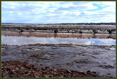 A  river runs through Moncton . A view of the icy banks on a cold March day. Low tide,,2019/03/20