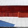 Red barn boards gleam in the early spring air!