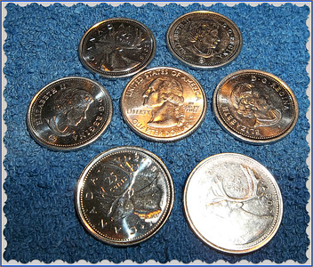 QUARTERS  FOR Q day  US in the middle and our Canadian  heads ,,the queen , and tails ,,a moose! Happy Sunday!!  I might be off line for a few days, but not to worry