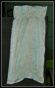 AN OLD KITCHEN TOWEL AFTER BEING TAKEN OFF THE CLOTHESLINE. FROZEN SOLID,,,NOW TO THE LAUNDRY ROOM,,   WE ARE IN A COLD ALERT,,CAN YOU TELL?   08/01/17 standing on the deck chair