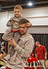This dad wanted his little boy to have a better view of the slot car track, so he hoisted him up.  I thought this was very sweet!<br /> <br /> Thanks for the enthusiastic comments on the colorful hot rod.  I sure appreciate your taking the time to stop and comment.  Thanks also to you folks who keep finding other shots of mine and commenting on them!  Always a nice surprise to see them turn up!<br /> <br /> Hope you have some fun today!