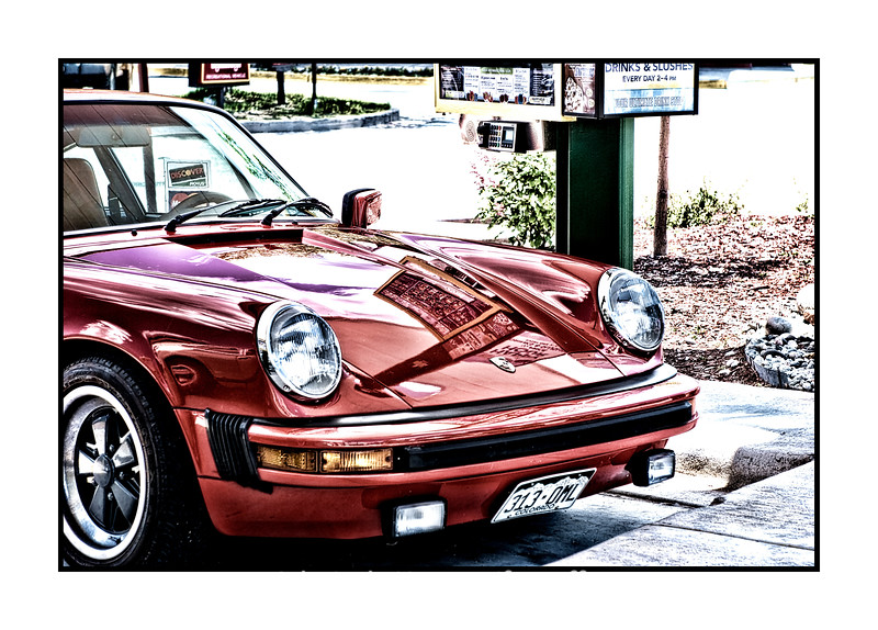 This is my 1975 Porsche, which we had restored a year or so ago.  I took the photo at the Sonic in Woodland Park, where we had driven for a Father's Day outing.  I forgot about the photos I took that day and just rediscovered them and processed them.  I've had the Porsche for about 20 years.  Thanks to everyone who commented on my Balloon Man and Little Girl shot.  I have to admit that I thought there was something sort of universal in the interaction between them.  The week seems to be barreling along.  I hope you have a good day today!