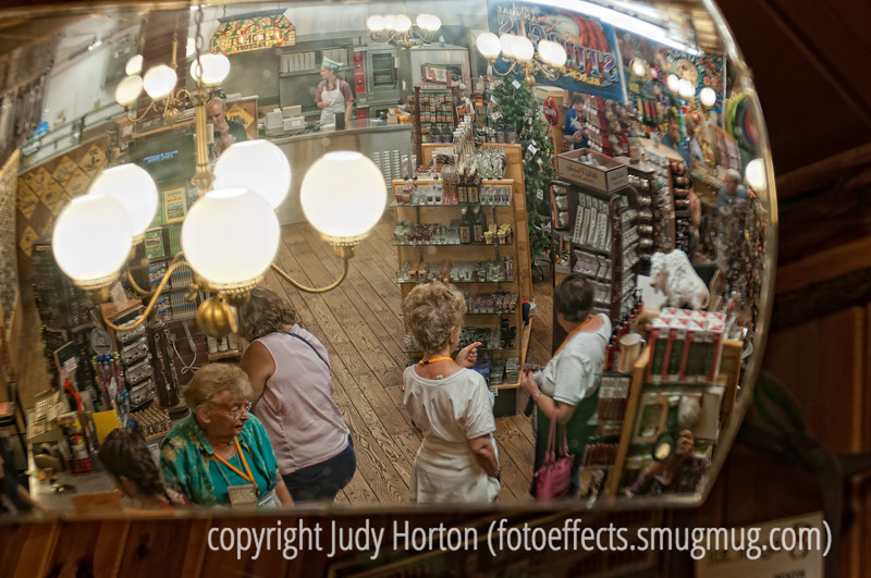 9/24/12 - A concave mirror in Wall Drug provides a bird's eye view of a small part of the store.  I thought it provided an interesting perspective.<br /> <br /> Thanks to everyone who commented on my pelican kaleidoscope for Prostate Cancer Awareness Day.  <br /> <br /> Constructive criticism is always welcome.  We have lousy 'Net access here, so I don't know how much commenting I'll be able to do.  I'll try, though.