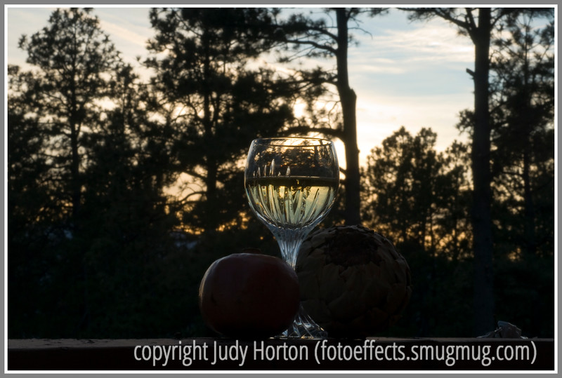 Day 37 - A still life at sunset --- composed of baccarat wine glass, white wine, pomegranate, and dried artichoke heart.