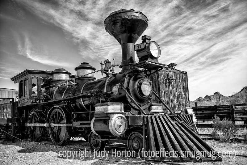 3/19/13 - Old locomotive at Old Town Tucson.<br /> <br /> Thanks so muich for your warm response, making my shot of the Presidio arches the #1 shot for the day.  A few more of you preferred the color version, but quite a few thought the b/w version was better.  Thanks for sharing your opinions with me!