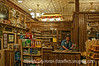 """9/11/12 - The Apothecary at Wall Drug in SD; best viewed in the larger sizes.  This was taken in quite low light.  Wall Drug was extremely crowded so I did not bring my tripod.  I just braced myself against a wall and hand held the shot.  This was shot at 1/60th sec. with a shallow dof and that is why the stud is blurred.  And, no, this is not an HDR shot.  I use tone mapping, dodge and burn to achieve similar looks.<br /> <br /> We've had quite a bit of discussion about using neutral density filters lately (see Ilene and Paul's posts) and I found a nice Gavin Hoey tutorial about them.  If you watch this tutorial, near the end Gavin also shows you how to get rid of chromatic aberration in CS6.  It is a bit harder in CS5 but you can do it in RAW.  Here is the link:  <a href=""""http://www.youtube.com/watch?v=iYG9HoE1i4I&list=UUB9r-KZLgvgtfQl3TvAgNJQ&index=3&feature=plcp"""">http://www.youtube.com/watch?v=iYG9HoE1i4I&list=UUB9r-KZLgvgtfQl3TvAgNJQ&index=3&feature=plcp</a><br /> <br /> Thanks for your comments on my shot of the Needles Highway scene.  As Paul pointed out, I should have cloned out the branches in the upper left.  Some of you wanted to see the color version, which can be found here:  <a href=""""http://fotoeffects.smugmug.com/Landscapes/Sylvan-Lake-and-Needles/25229846_pjjcmw#!i=2026528725&k=6wn2dNh"""">http://fotoeffects.smugmug.com/Landscapes/Sylvan-Lake-and-Needles/25229846_pjjcmw#!i=2026528725&k=6wn2dNh</a>.  Sorry for the confusion on the dates.  I'm terrible about dates and rarely know what date it is.  I did check to see the date on my previous posting, but, apparently, I had the wrong date on it, as well.<br /> <br /> Constructive criticism is always appreciated."""