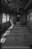 7/24/12 - Train car; best viewed in the largest sizes.  Hill City, SD has an old train station with a train that runs a number of times a day from there to another small town nearby.  It also has a train museum and a whole bunch of old, decaying train cars.  This is the inside of one of those old passenger cars.<br /> <br /> Thanks for commenting on my shot of the ant dragging the bee.  Much appreciated!  Hope you are having a good week!