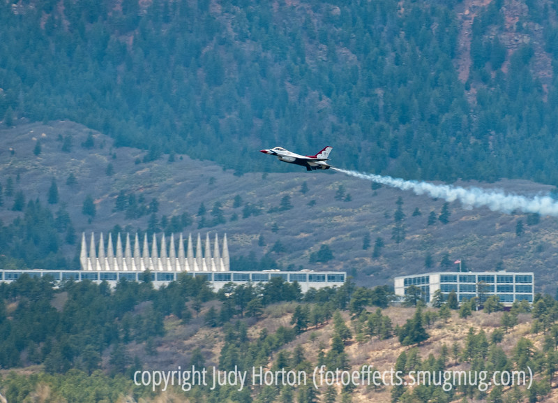 A U.S. Air Force F-16 Flying Falcon Thunderbird jet flies near the USAF Academy chapel during the flyover ceremony at the USAF Academy graduation.  Again, this shot is not as sharp as I'd have liked, but it is rare to see a shot of any of the Thunderbirds in front of the Academy chapel.<br /> <br /> Wow!  Today was very strange for me.  An older shot of mine of the cowboy statue held the number one position for the day.  I was absolutely overwhelmed with the response to this older shot.  Some of you read the caption on the shot and thought we were having snow today.  Although we had snow about a week ago, today was actually sunny and reasonably warm.  The shot I actually posted today was much further back.  Thanks, also, to everyone who posted comments on other older shots of mine today.