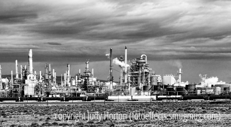 An oil refinery in Wyoming; best viewed in the larger sizes.  Taken in June.  I am fascinated by industrial scenes, although I don't have a lot of opportunity to photograph them.  I liked this black and white because of the high contrast in it.  I actually shot this from our moving car.<br /> <br /> Thanks a bunch for the comments on my shot of the Grand Tetons.  Also, thanks to those of you who commented on some of my older shots today.  I was surprised to see so many of them pop up as I went through the photos.  Have a great day!