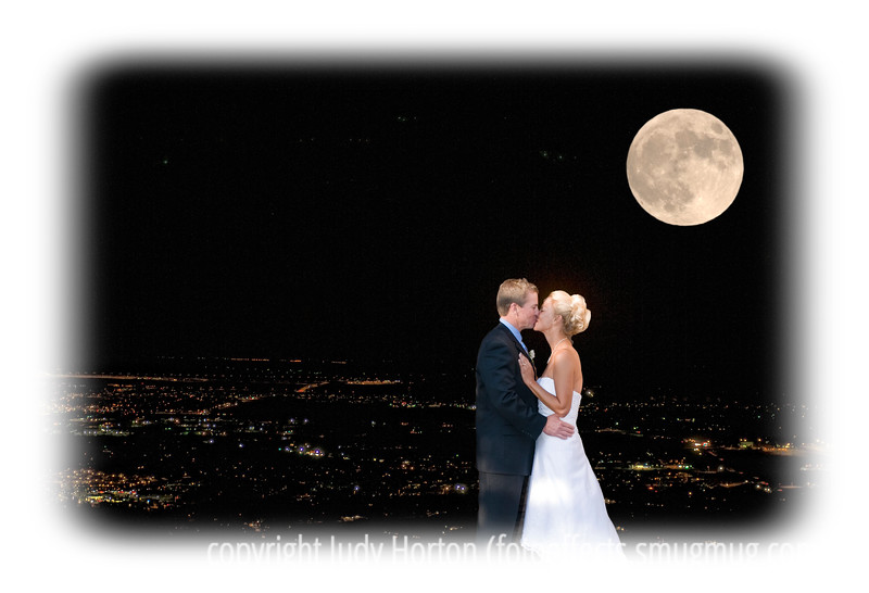 Chris and Tracy's Wedding - This lovely couple got married at the Cheyenne Mountain Will Roger's Shrine and had their reception at the Moose Lodge at the zoo.  It was a lovely night.   The location is high up looking over the city of Colorado Springs.  And, to boot, they had a full moon.  I took several shots of them with long exposures, but due to some movement on their part (breathing, etc.), I was not satisfied with the images.  So, I took a shot of the moon and city lights and then added them into it.  I know some of you don't think is fair, but I wanted to give them the shot they desired and this seemed the best way to do it.<br /> <br /> Thanks for the nice comments again on my ballon festival shot.  I've spent a long day processing images from another wedding.  Hope everyone has a great day on Saturday!  I'm posting this and then hitting the sack.