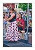 Flamenco Dancer and Musician - this lady was entertaining folks at the Cherry Creek Art Festival on July 4th.  The guitarist really seemed to be enjoying the performance, but the little girl to the right seems bored (she might be the daughter of one or both of the performers, I'm guessing).  We've had storms here all day and I spent most of my time processing images from a photoshoot with three small children, so did not even get my camera out.  I'm sure some of those shots will make their way to my dailies --- once I finally get them all done.  Seems like the entire country is having serious weather of some sort.  Have a good day!  Pearl's Lisa is having her surgery today and I know all of us are hoping it is a success.