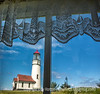 8/14/13 - Cape Blanco Lighthouse as viewed from the museum/giftshop window.  I thought this was a rather unique pov for a lighthouse shot.  The glass was a bit dirty and not of the best quality, so the shot wasn't quite as sharp as I'd have liked.<br /> <br /> Thanks to everyone who commented on my shot of the Bandon beach wave action.  For some reason smugmug picked up my shot today and actually put it into the dailies, as it did for a few other folks, while ignoring many other people's posts.  I hope I found most of your posts to comment on, but the process is a bit cumbersome, to say the least.  Have a great day!
