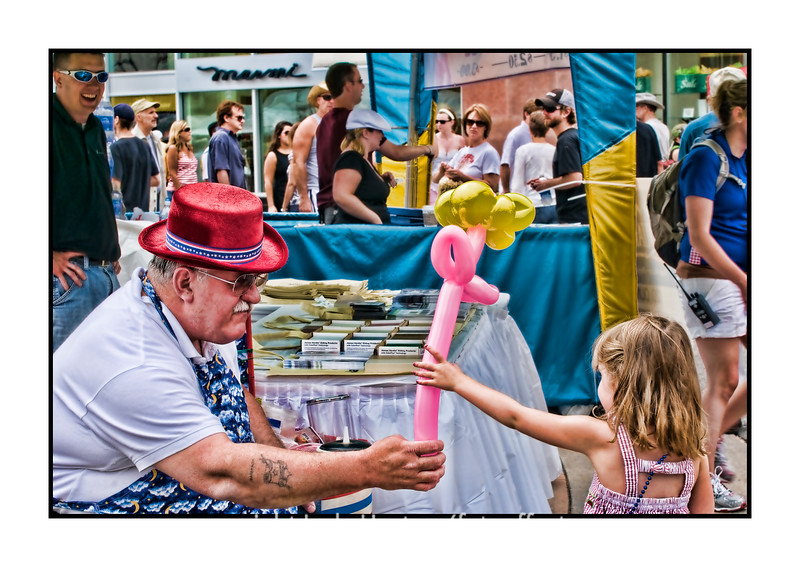 "Balloon man and little girl at the Cherry Creek Arts Festival on July 4.  I loved her slender little arm and tiny hand, contrasting with his much larger hand on the balloon.  The other shots that I took at the festival are here, in case anyone is interested:  <a href=""http://fotoeffects.smugmug.com/gallery/8821058_W2b4S#584367827_Bseyn"">http://fotoeffects.smugmug.com/gallery/8821058_W2b4S#584367827_Bseyn</a>.  Have a great day, everyone!"
