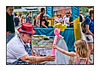 """Balloon man and little girl at the Cherry Creek Arts Festival on July 4.  I loved her slender little arm and tiny hand, contrasting with his much larger hand on the balloon.  The other shots that I took at the festival are here, in case anyone is interested:  <a href=""""http://fotoeffects.smugmug.com/gallery/8821058_W2b4S#584367827_Bseyn"""">http://fotoeffects.smugmug.com/gallery/8821058_W2b4S#584367827_Bseyn</a>.  Have a great day, everyone!"""
