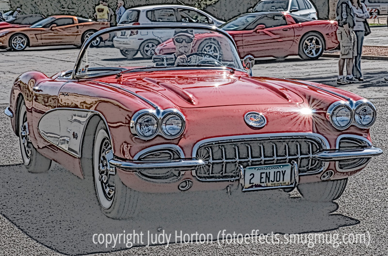 The license plate says it all - A vintage Corvette convertible.  When we were on our way to visit some galleries in Scottsdale one afternoon, we passed a little lot where there was a small show of some vintage Corvettes.  On our way back to our campsite, we pulled in and I quickly grabbed a few shots.  I almost missed out because the cars were in the process of leaving.  This was one of the nicest at the little shot and I decided to play around with it a bit in PS.  One of the things I like about the image is the various starbursts I captured.  Hope you like it.<br /> <br /> I have to say I was amazed at the response to my yellow columbine which kept it in the number one spot all day.  I guess I'm not a good judge of my own photos, since I thought it was a nice shot but nothing too great.  Anyway, you all certainly made me feel good today and I appreciate all the support.  And, to think that Maryann's shot of a columbine really had about the same number of comments as mine.  I loved her shot with the water drops.<br /> <br /> It is raining here but I hope it clears out enough that I can stake out a fox's den about a half block from my house.  I spent 2.5 hours camped out near there today and did not get a single glimpse of the fox or babies.  But, I'm determined.  The kits are quite young, so, hopefully, before they leave the den I'll be able to get some decent shots.  Have a good day, everyone!