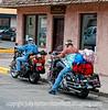 A couple on motorcycles; best viewed in the largest sizes.  We'd been following this couple and I'd been trying to get a shot when they pulled over and gave me this opportunity.  I thought they were quite colorful and interesting.<br /> <br /> Thanks for the nice comments on my street scene.  Much appreciated!  Hope your weekend went well!
