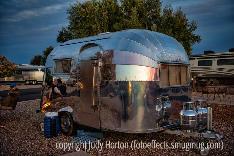 3/2/13 - Sunset and a campfire are reflected in a vintage Airstream trailer; look at the front tanks in the largest sizes to see the entire sky reflected.<br /> <br /> I've been unable to post or comment for a couple of days due to no 'net access.  Thanks so much to everyone who commented on my hummer shot the other day!