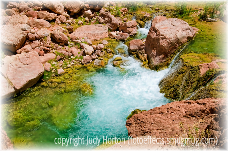 Day 107 - One of the many small waterfalls on Havasum Creek in the bottom of the Grand Canyon; the detail in this image is best viewed in a larger size.  Havasu Creek is arguably one of the most beautiful places in the world and is part of the Havasu Indian Reservation.  A major flood took place a month or so after we rafted the Colorado last summer and took out lots of trees and moved lots of boulders around. The water is so intensely blue-green because of the presence of travertine.  When you raft the Colorado with a larger group, you get to visit sites like this mainly in the mid-day.  The light on the day we were there was incredibly bright, actually making it difficult to capture images as faithfully.  Thought you might enjoy seeing this in the doldrums of winter that we are having.  Have a great day!