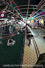 Neon Diner - This is the interior of Rosie's Diner in Monument, Colorado. It, too, was taken with the 10.5mm fisheye lens, which has made the interior seem longer than it really is.<br /> <br /> Thanks for the comments on today's balloon festival shot.  I'm sure you are getting tired of them, so I thought I'd give you a break.  Hope you have some fun today.  Laughter IS the best medicine!