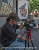 7/20/14 - Videographer at the Cherry Creek Art Festival; I was taking a break on the curb and he came and set up right in front of me.  I asked if I could shoot him while he was shooting everyone else.<br /> <br /> Thanks, Rick, for the logo challenge.  I discovered it is more difficult than I'd have thought to get logos without the company name integrated into them.  I really enjoyed seeing everyone's initial logo shots.  It was interesting how many I'd had in my home and never noticed.  Thanks for your comments on my Dodge Ram logo.  In an rv park, there are always lots of trucks and at least half of them must sport that logo.  No surprise that everyone knew it!