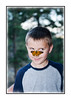Hey, What Should I Do Now?<br /> <br /> My grandson, Spencer, with a butterfly on his nose.  Regretfully, I must admit that this is a fake.  Two separate photos.  I cut out the butterfly from another image and moved it onto Spencer's nose.  I've always wanted to capture a shot like this, so I decided to create it from scratch.  Thanks, everyone, for taking the time to give me advice about how I could improve the HDR-like suburbia shot. You gave me some really good suggestions, so I'll keep working on it.  Tatiana asked what I used to cut out the butterfly.  I used Photoshop CS3, the magic wand tool (which is so much better in CS3 than it was in previous iterations of the software).