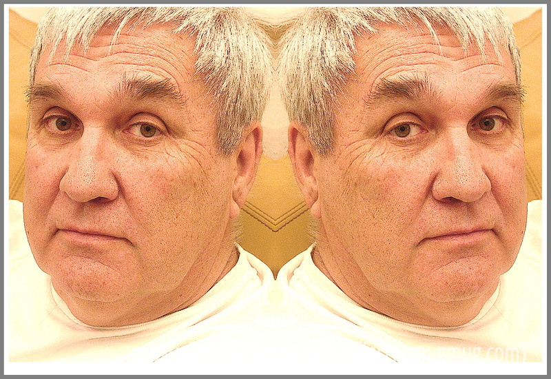 Day 31 - I took this shot and then created a mirror image using Photoshop.  Probably one of him is enough, however!  Ha!