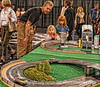 Chip Off the Ol' Block; best viewed in the larger sizes.  Taken at the Denver Car Show.  Daddy was proud-as-punch of his little one who was doing a great job racing the slot car.<br /> <br /> Thanks for your comments on my shot of the bubble up bottles at the World Market.   Sure enjoyed perusing your creative and beautiful shots today.  Did you all see the one of the hundreds (or more) Monarch butterflies all clustered together...really amazing!  It was a gorgeous springy day here today.  Hope you had an equally nice one.