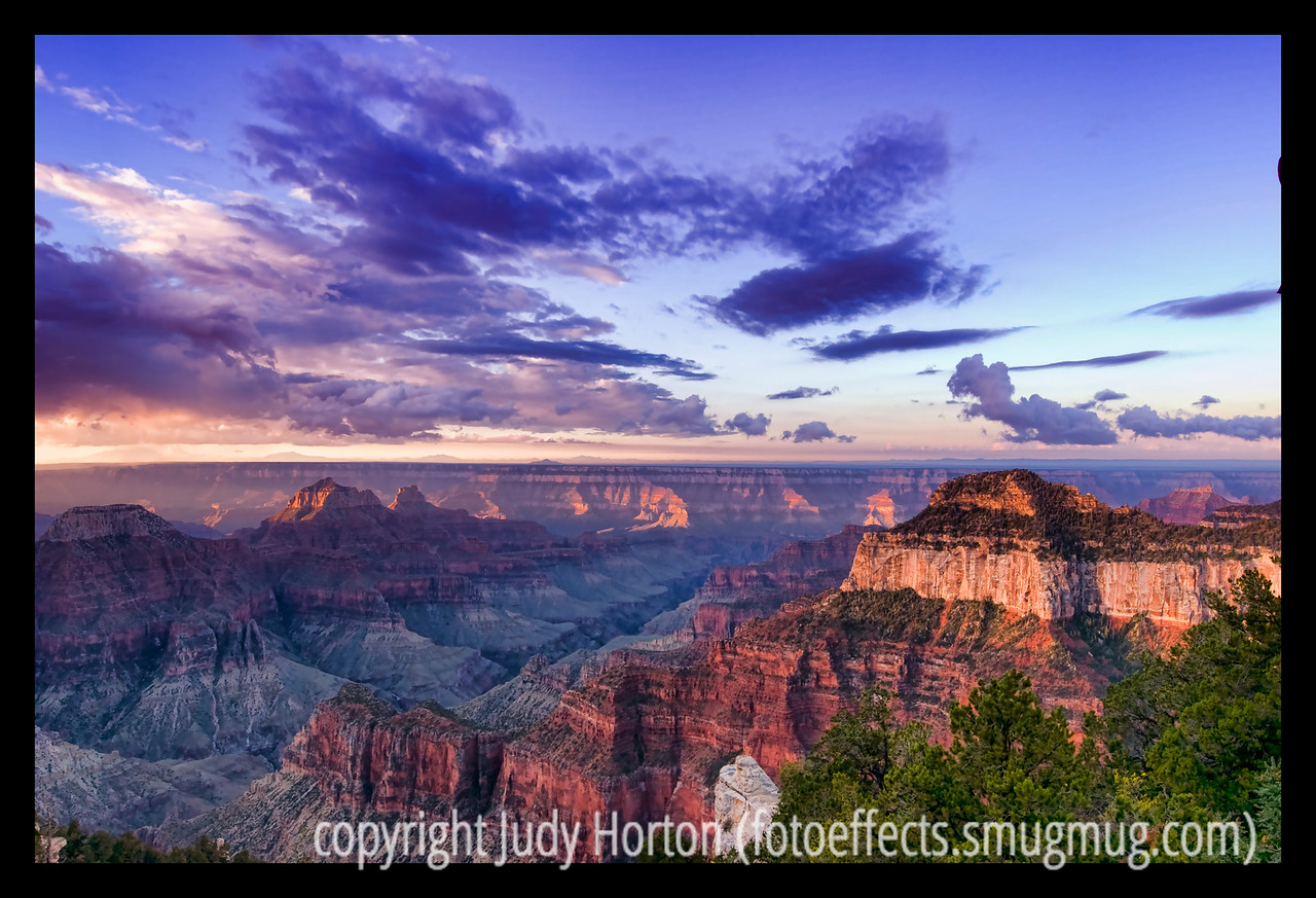 """Day 132 - The morning sun strikes rock formations in the Grand Canyon, as seen from the North Rim in Arizona; detail in this image is best viewed in a larger size.  This shot of the Grand Canyon is one I recently rediscovered in my archives from the early fall and reprocessed.  I used a number of different effects, including Topaz Adjust, Color EFEX Pro, and some regular Photoshop filter and blending effects.  If you view the large size, you will really see some detail!  I'm going to post this and go to bed.  I hope you all have a really nice day!  It is supposed to be quite warm here today.  It got up to 65 degrees in Colorado Springs today, not a good day to sleep away.  Oh. well.  Oh, if some of you should like to look at the other North Rim Grand Canyon shots, they are here:  <a href=""""http://fotoeffects.smugmug.com/gallery/6698528_KNq6d#476011624_efKkk"""">http://fotoeffects.smugmug.com/gallery/6698528_KNq6d#476011624_efKkk</a>."""