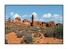 In Arches National Park in Utah; I think this one needs to be viewed in the larger sizes.  In the original shot, the sky was just blue, so I replaced the sky.<br /> <br /> Thanks so much for the nice comments on my shot of the orchid buds.  We did get Phil and new computer today, an iMac with a 27 in. screen.  I work on a Macbook Pro normally and the difference between the size of his screen and mine makes me want to trade with him.  So, I spent a good portion of the day pulling all the cables and cords from the old PC arrangement out and then hooking up everything again.  It is rewarding, though, when everything is set up and actually works.  Hope your weekend is relaxing.
