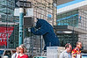 Big Blue Bear outside the building where the auto show was held.  I liked this one for a number of reasons --- the interesting reflections in several places, the oversized bear which is such a surprising thing to see in this context and the people going about their business on the street.  Hope you find something of interest here, too.<br /> <br /> Thanks for your comments on my RC helicopter shot.  So many wonderful shots on smugmug today.  Really has me psyched to improve my photography skills!