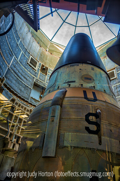2/11/13 - Titan long range ballistic missile at the Titan Missile Museum in its silo.   Per the terms of the Cold War, we had to do various things that would make it impossible for the missile launch sites to be viable in the future.  One of these was to cut holes in the inside walls of the silo.  The museum decided to make these holes into viewing windows so that visitors could actually see the missile.  The first iteration of the missile used a fuel mixture that took, I think, about thirty minutes to prepare it for firing.  Later, a new fuel mixture was instituted that could allow a missile to be launched in 30 seconds.  The folks operating the launch site would not have received any feedback on whether their missile successfully reached and destroyed its target, since the assumption was that these missiles would never be launched unless Russia had already launched missiles at the U.S. and it was expected in this case for destruction of both countries to be virtually complete.  The missile site had big radio antennas for communications that could be completely retracted into the ground.  There were three of them, so that if one was destroyed, another could be raised up out of the ground to replace it.  Each day the folks manning the site would go through a series of tests of every system involved in the missile and the site.  In spite of this, there were many hours when they had virtually nothing to do and boredom was their greatest trial.<br /> <br /> Thanks so much for your warm reception to my shot of the vintage Airstream.  I do appreciate every one of them!