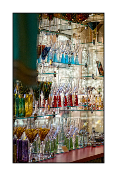 A glimpse into a shop selling glassware.  The shop is in the Tlaquepaque shopping center in Sedona, Arizona. The shot is best viewed in the largest sizes. Thought I'd give you a bit of a break from the great blue heron pics.  <br /> <br /> Thanks once again for all the comments on the most recent blue heron photo.  I'm humbled by all the nice comments.  Clearly, I had a wonderful time watching and photographing these birds...or I would not have spent so much time doing it.  I sure enjoyed all your photos today, folks.  I did not do a lot of processing today.   Actually, I spent quite a bit of time lounging by the pool, trying to get some tan on my ugly, white legs.  Hope you find a way to enjoy yourself today!