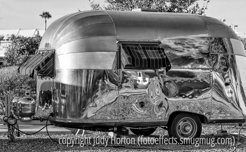 "2/10/13 - Vintage Airstream; our RV park is hosting an Airstream rally and this is one of the trailers at the rally.  I had a hard time deciding between the color and b/w version.  The color version is here:  <a href=""http://fotoeffects.smugmug.com/Other/Odds-and-Ends/7032233_dn3zKD#!i=2358443840&k=7kf6Lkv"">http://fotoeffects.smugmug.com/Other/Odds-and-Ends/7032233_dn3zKD#!i=2358443840&k=7kf6Lkv</a>.  Which do you prefer?<br /> <br /> Thanks so much for your supportive comments on my shot inside the Titan Missile Museum.  I'll have a few more postings from there before I'm done with it."