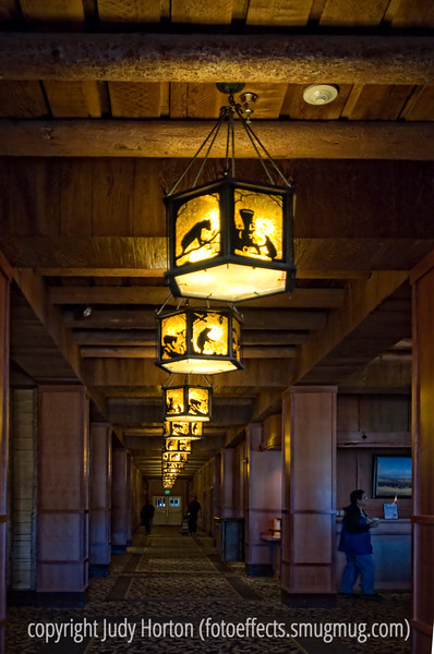 A hallway in Yellowstone Lodge with unique Craftsman style light fixtures<br /> <br /> I appreciated the votes of confidence on my bubble shot.  Made me feel good that some other folks liked that odd kind of shot as much as I did. Another weekend.  Hope your will be super!