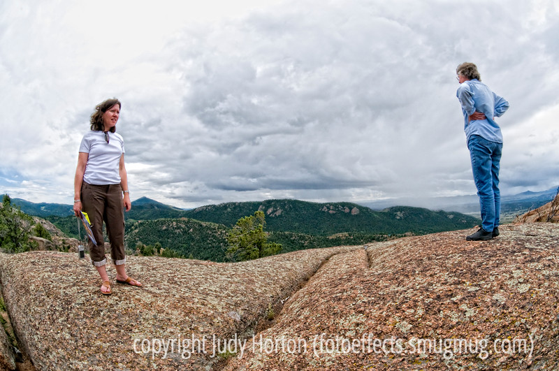 This was shot near Cripple Creek, Colorado, in an area of huge rocky outcrops and gigantic boulders, which are scattered around the mountains.  The somewhat odd perspective is due to the fact that I shot it with my 10.5mm/f2.8 fisheye Nikkor lens.  I did straighten the lady on the right a bit to make the perspective more realistic.  It has also been processed with Color EFEX Pro and some Photoshop filters and blending modes, although nothing too major.  The young woman on the left is my younger daughter.  <br /> <br /> Hope your day goes well.