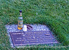 Remembering a friend.  We were attending a funeral and inurnment at the U.S. Air Force Academy for one of my husband's squadronmates, a general who had recently died.  As we were about to leave the cemetery, we noticed this liquor bottle and the paper cups sitting on one of the grave markers.  The previous weekend there had been a class reunion at the academy and we surmised that some friends of Harold James Bennet had visited his grave and had a few drinks in his memory, leaving behind the rest of the bottle as a token of their esteem.  I thought you all might be interested in seeing it.<br /> <br /> Thanks ever so much for making my shot of the Air Force Academy Chapel your #1 shot for the day.  I am so humbled that you would like that one so much when there are so many wonderful shots on smugmug.  Really made my day, though!  Hope you were rejuvenated by the weekend and ready for the week to begin.  Enjoy!