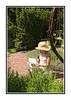While shooting flowers at the Denver Botanical Garden, I noticed this woman out of the corner of my eye.  She was taking notes about something in the garden.  I really liked her hat and outfit, as well as the light on her, so I snapped a few quick pics of her.  I processed this one so that it would look more painterly.  Thanks for all the nice comments on my looking through the hole in the fence picture.  I must admit that it is one of my personal favorites.  Have a great day!