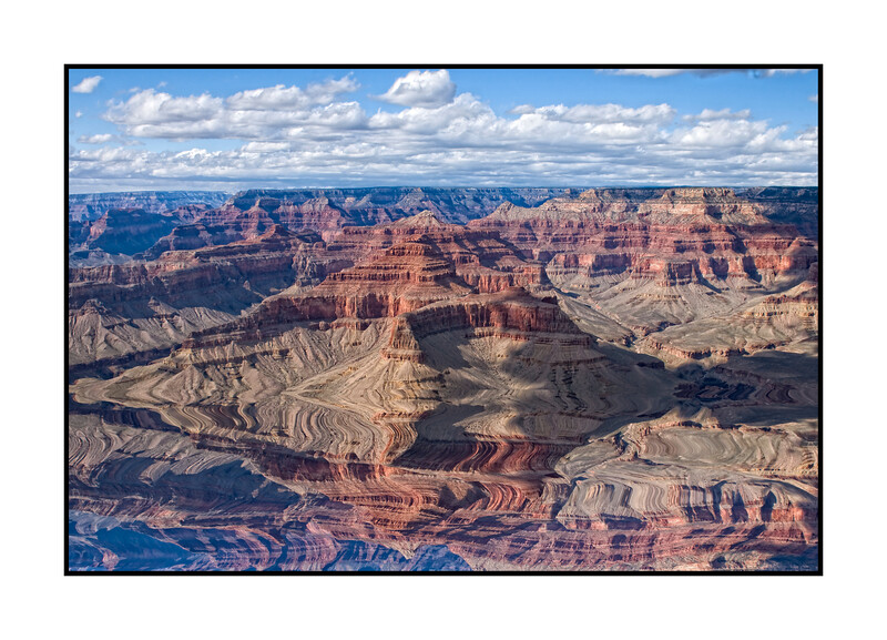 View of the Grand Canyon from the South Rim with clouds making shadow patterns on the formations.<br /> <br /> Thanks for the comments on the shot of the cactus.  Really appreciated.  Enjoy your day!