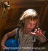 What IS that?  This little girl was the flower girl at a recent wedding shoot and I noticed that she was looking at the light coming in from a stained glass window onto her hand.  She was absolutely fascinated!<br /> <br /> Thanks so much for the many nice comments on my latest balloon festival picture.  These festivals do provide so many great photo ops.  It really made my day to see so many of you liking my image.  I love to imagine all of us SmugMuggers, going about our days with our cameras at hand, always on the lookout for a great shot.  I see us at work with our cameras, sitting in the car with them on our laps, with us in restaurants and bars, and everywhere we go.  We can be found lying on the ground, perched on fences, teetering on ladders, wading in streams.  We are fearless; we are strong; we are indomitable; we are smugmuggers!<br /> <br /> Enough, already!  Have a great day!