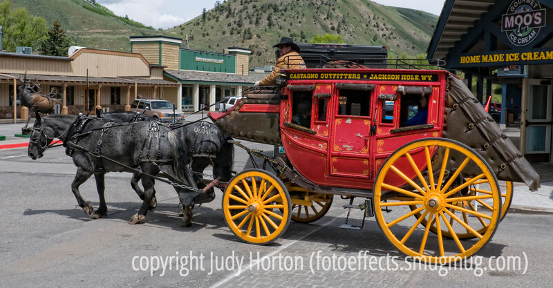 An antique stagecoach in Jackson Hole, Wyoming.  It is driven around the square in town and people can ride in it.  Quite picturesque!  This was taken last June but I just recently processed it.  Hope you enjoy it.<br /> <br /> I appreciated the comments on my portrait of Duncan and Quinn.  Thanks, as always for taking the time to stop and comment.  Thanks, also, to those of you who browse some of my galleries and comment on some of those shots.  <br /> <br /> Hope you are enjoying some nice photo opportunities.  I'm in a bit of a funk, inspiration-wise.  I'm going to have to go searching for new places to take pics.