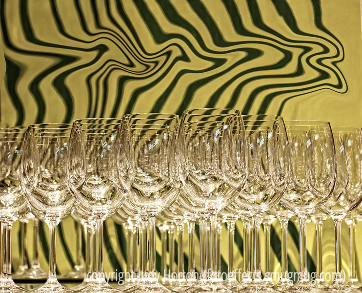 """An array of glass goblets at Crate and Barrel.  I changed the stripe design with """"liquify.""""  Probably best viewed in the largest sizes.<br /> <br /> You guys are so great.  It was wonderful to see all the SPs and know that so many of us were working on the same challenge.  I so enjoyed seeing the faces that go with the photos I've been admiring for so long.  And thanks to all of you for making me feel better about a shot of myself.  I must admit that I think I look better in a faded version where people cannot see my wrinkles and the effects of gravity.  Hope you had a good weekend.  It was my daughter's birthday and we had the family over for dinner.  Hope your week is off to a good start."""