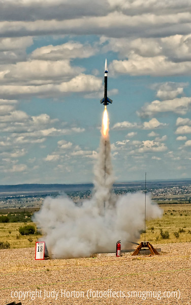 "Rocket launch at NARAM 52 (National Association of Rocketry Annual Meet) - We spent much of today with our grandkids at NARAM, which is being held this week near Pueblo, Colorado.  There were lots of neat rockets launched and we all had a great time.  The grandkids have all built and launched rockets for several years and were thrilled to get to see some of the high powered rockets (you must be eighteen to be able to puchase the motors for those and to obtain the necessary certification to fly them.)  Also, you need to have FAA clearance for many of them, as they go high enough to potentially interfere with air traffic.  I have a gallery of these shots under the ""Other"" category if any of you are interested.  I will be adding in  information on the specific rockets that are launched, but I have to consult with my grandson to do that.<br /> <br /> Have a great day!"