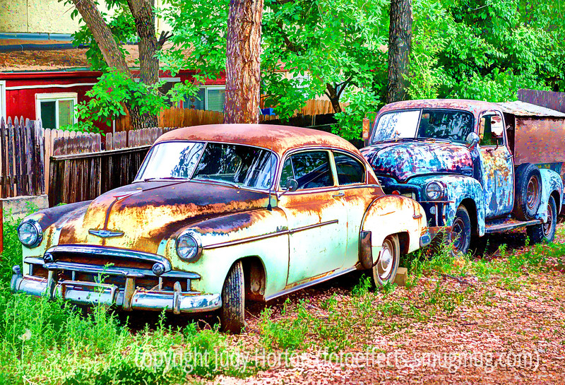 7/19/14 - Old cars; these were just a short distance from the Ivywild School, sitting in someone's back yard.  This version of the shot has been subjected to a lot of processing, including a lot of customization in Topaz Simplify.  Let me know what you think.<br /> <br /> Thanks for your comments on my collage of the alphabet letter shapes.  I really enjoyed your shots, too!  Everyone has been posting such excellent shots!