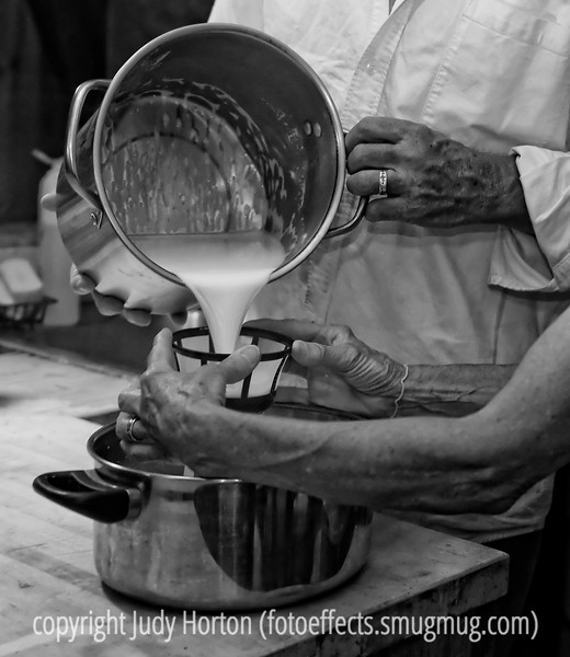 Pouring the milk through a strainer after milking the goat.<br /> <br /> Thanks for all the nice comments on my shot of the aspen trees in spring.  I'm looking forward to getting some fall shots here in Colorado, but must admit I'm in no hurry for fall to come.