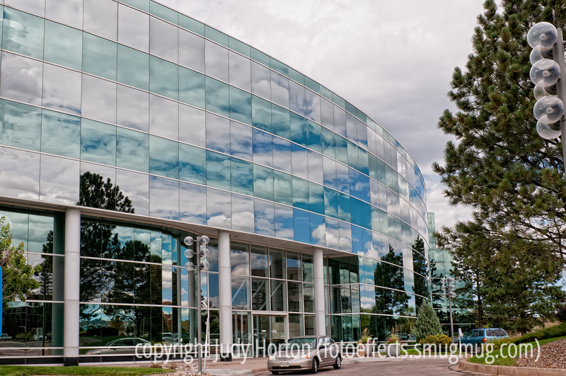 Reflections of the sky in an office building; best viewed in the largest sizes<br /> <br /> Thanks for the comments on my shot of the balloon festival.  Our snow did not materialize...the storm went south of us.  Have a good day!