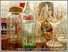 This still life composition of advertising tins and glass and crystal has been manipulated in Photoshop to emphasize the reflections and create an image that is similar to a fine art silkscreen print.  You need to view it in the larger sizes to see this effect.  I took this shot a long time ago but my recent coke bottle shots got me looking over some of these older still lifes.  I have not printed and framed many of my shots but I do have this one framed and blown up to about 20 x 24 on one wall.<br /> <br /> Thanks for your comments on my grocery store orchid shot.  Much appreciated.  I'm pooped tonight, as I helped my daughter paint a couple of rooms in her house today.  Nice to see the change in a room happen so quickly.<br /> <br /> Have a great Sunday!