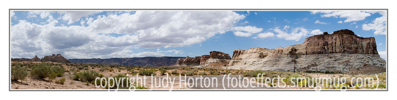 Day 23 - Panorama - taken along a road in Utah not too far from the dam at Lake Powell.  I don't generally post more than one shot a day, but I wanted to participate in the panorama challenge that Art issued, although I had not had a chance to take any recent panos.  I don't remember the exact number of shots included in this pano, but there were at least nine.  As you can see, the scene encompasses both sides of the road.  I combined them using Photoshop CS3.  I did use a tripod.<br /> <br /> I have actually blown up one of my panos in a 13 inch x 65 inch size and framed it.  ePengo printed it for me.  This is not the one I had printed.  I couldn't remember which gallery it was in.