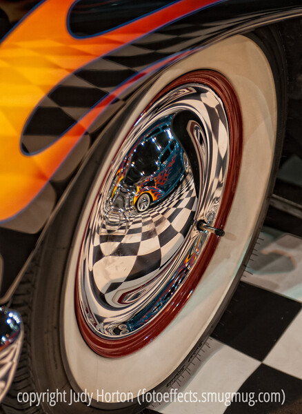 Reflections in a Wheel; best viewed in the larger sizes.  This particular reflection was one of my favorite takeaways from the car show!  <br /> <br /> Thanks for your comments on the shot of the father with the little girl playing with the slot cars.  Keeps me going!
