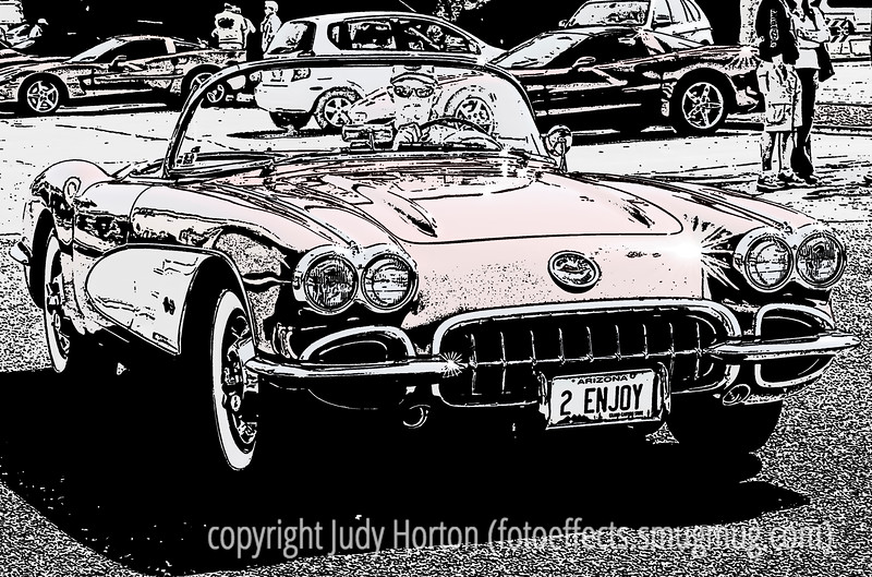 A vintage Corvette at a small gathering of Corvettes in Scottsdale, AZ, last year.  I was in the mood for a car shot and I had played around with this one a bit to give it a look more like a silkscreen print, or, possibly, a woodcut.<br /> <br /> Thanks a bunch for your comments on my shot of the lizard.  No, he wasn't a pet.  I went to a local reptiles store to shoot some snakes and lizards.  The shot was made through a very dirty glass but I was pleased with the detail and colors.<br /> <br /> Hope your week is going well.